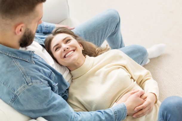 Loving couple relaxing on sofa, cozy warm leisure day